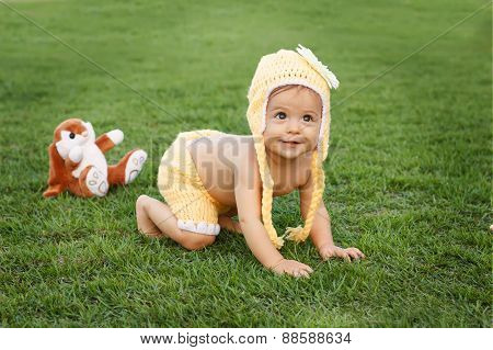 Cute Happy Smiling Little Baby Girl Crawling In Park