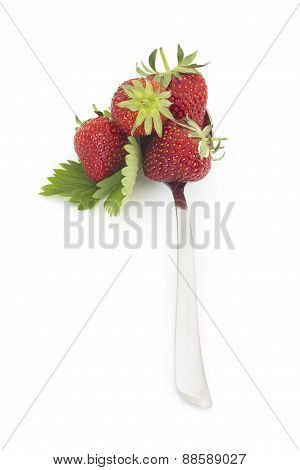 Fresh strawberries  spoon on white