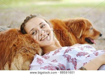 young woman with her dog outdoors.