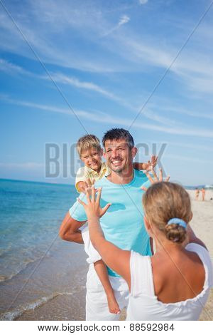 Father and kids at the beach