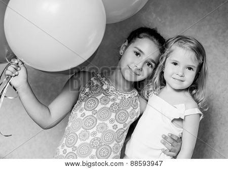 Cute Sisters With  Balloons
