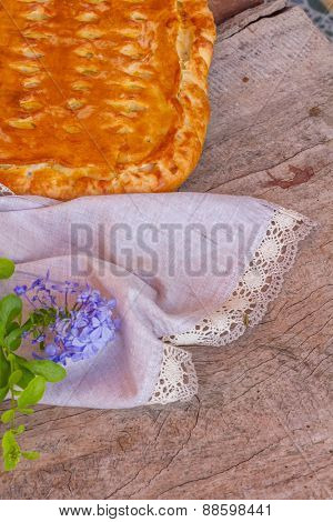 apple pie close up on a natural wooden background