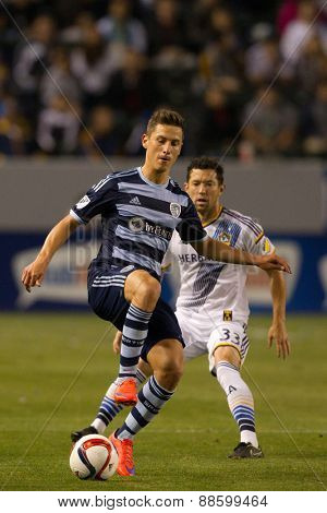 CARSON, CA. - APR 18: Dan Gargan & Krisztian Nemeth (L) in action during the L.A. Galaxy game against Sporting Kansas City on April 18, 2015 at the StubHub Center in Carson, California.