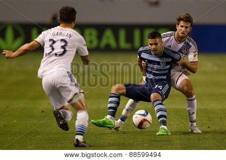 CARSON, CA. - APR 18: Tommy Meyer & Dominic Dwyer (mid) in action during the L.A. Galaxy game against Sporting Kansas City on April 18, 2015 at the StubHub Center in Carson, California.