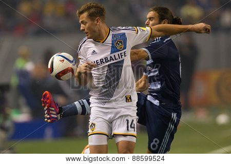 CARSON, CA. - APR 18: Robbie Rogers & Graham Zusi (R) in action during the L.A. Galaxy game against Sporting Kansas City on April 18, 2015 at the StubHub Center in Carson, California.