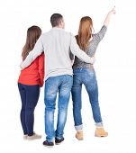 stock photo of side view people  - Back view of three friends pointing - JPG