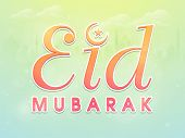 picture of eid mubarak  - Colorful text Eid Mubarak with moon and star on mosque silhouette cloudy background for muslim cumminty festival celebration - JPG