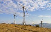 foto of wind-power  - Three wind turbines on a wind power farm - JPG