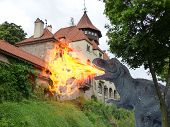 picture of prehistoric animal  - Attack of flame prehistoric monster to old castle