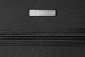 pic of zipper  - zipper and metal tag on black texture background - JPG