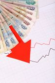 stock photo of paycheck  - Money and red arrow on graph document close up - JPG