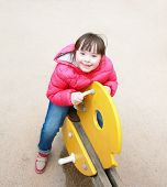 picture of playgroup  - Little girl playing on the playground  - JPG