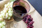 stock photo of grape  - red grape juice in glass with grape on background - JPG