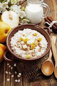 stock photo of ceramic bowl  - Oatmeal with caramelized apples in the ceramic bowl - JPG