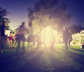 foto of moonlit  -  people mingling at a free concert by local musicians in a garden st night with a long exposure toned with a retro vintage instagram filter effect app or action - JPG