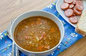 stock photo of sausage  - Lentil soup with sausages and potatoes - JPG