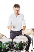 pic of drum-kit  - Handsome guy behind the drum kit on a white background in shirt and trousers - JPG