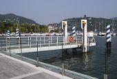 stock photo of pier a lake  - landing stage at pier Como lake Como Italy - JPG