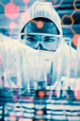 picture of protective eyewear  - Science formula against protected scientist dropping liquid in a test tube - JPG