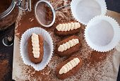 picture of cake-ball  - Chocolate rum balls cakes decorated with cream and cocoa - JPG