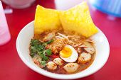 stock photo of gai  - Pork noodle tom yum condensed water egg - JPG