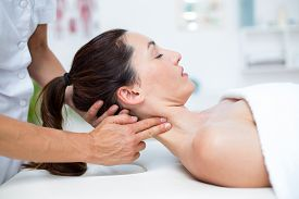 stock photo of physiotherapist  - Physiotherapist doing neck massage in medical office - JPG