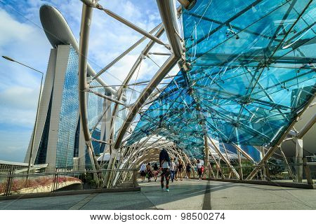 SINGAPORE - MARCH 29: The Helix Bridge on MARCH 29 2015 in Singapore is a pedestrian bridge linking Marina Centre with Marina South in the Marina Bay area in Singapore.