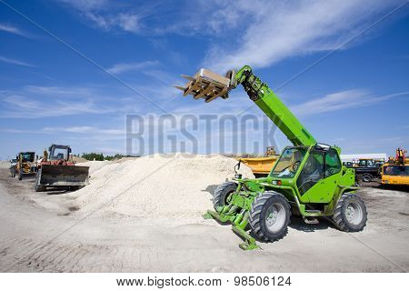 Construction Vehicles At Building Site