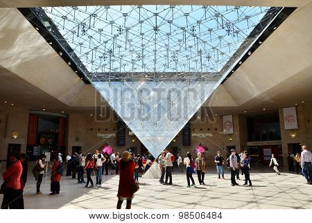 Paris, France - May 13, 2015: Tourists Visit Inside The Louvres Pyramid On May 13, 2015 In Paris