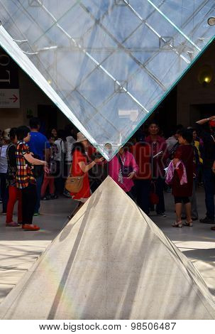 Paris, France - May 13, 2015: Tourists Visit Inside The Louvres Pyramid On May 13, 2015 In Paris.