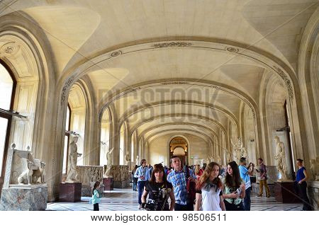 Paris, France - May 13, 2015: Tourists Visit Interior Of Louvre Museum On May 13, 2015 In Paris.