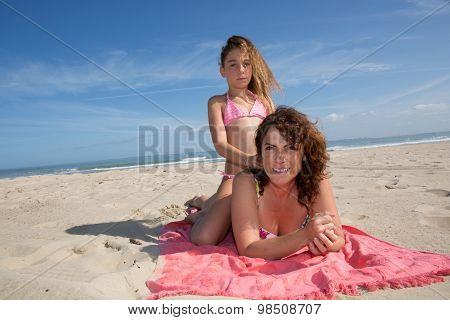 Complicity Between A Mother And Her Daughter At The Beach