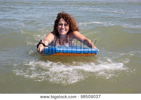 Woman With Curly Hair At The Ocean