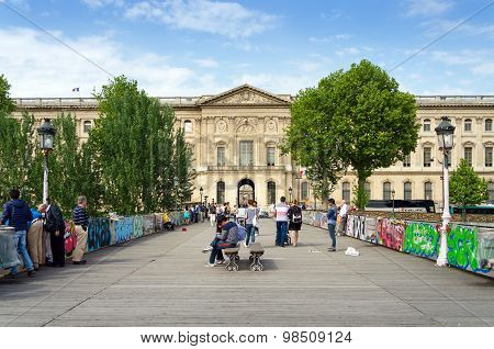 Paris, France - May 13, 2015: People Visit The Pont Des Arts In Paris