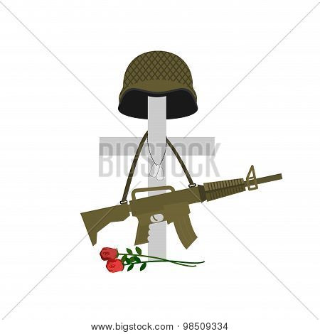 Grave Of A Fallen Soldier. Death Of The Military. Cross And Helmet. Automatic Gun Hanging On Monumen