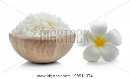 Rice In Wood Bowl And Flowers Frangipani On White Background