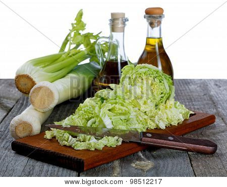 Shallots Cabbage And Olive Oil On A White Background