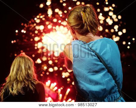 Girl looks to firework show