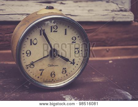vintage photo of a retro soviet alarm clock
