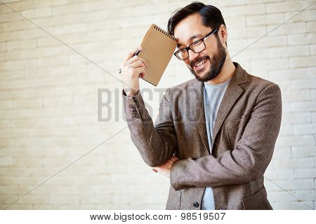 Happy businessman with notepad in isolation