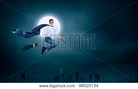Businessman on broom