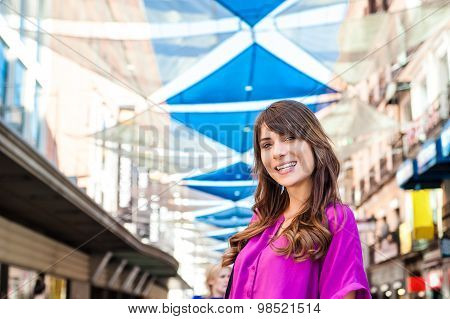Young woman tourist in Plaza del Sol, Madrid, Spain, taking a walk and enjoying the city.