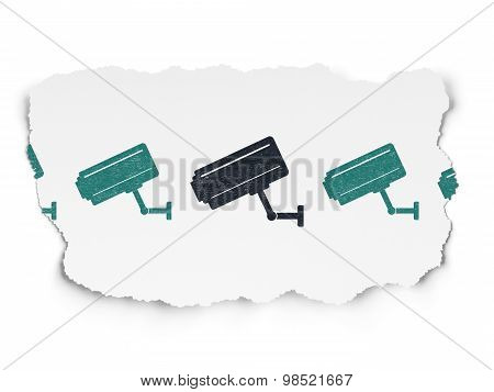 Protection concept: cctv camera icon on Torn Paper background