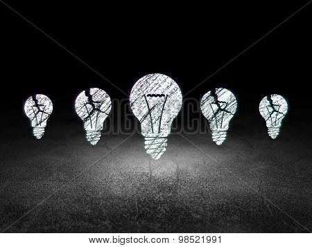 Business concept: light bulb icon in grunge dark room