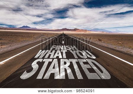 Finish What You Started written on desert road