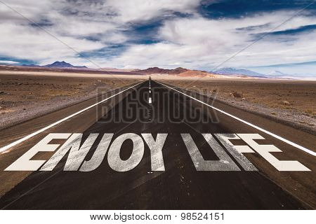 Enjoy Life written on desert road