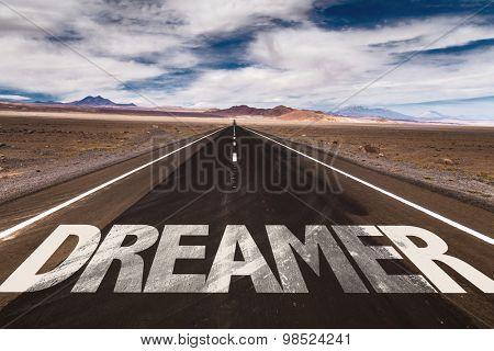Dreamer written on desert road