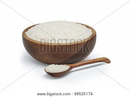 White rice in wooden round bowl