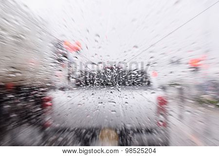 Rain Drop On Car Grass With Motion Blur Effect ,concept For Drive On Rain