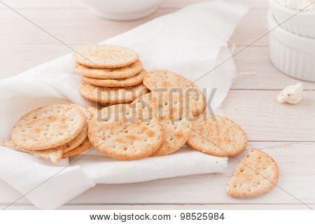 round crackers on white linen napkin